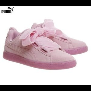 Pink PUMA Basket Heart sneakers with large bows